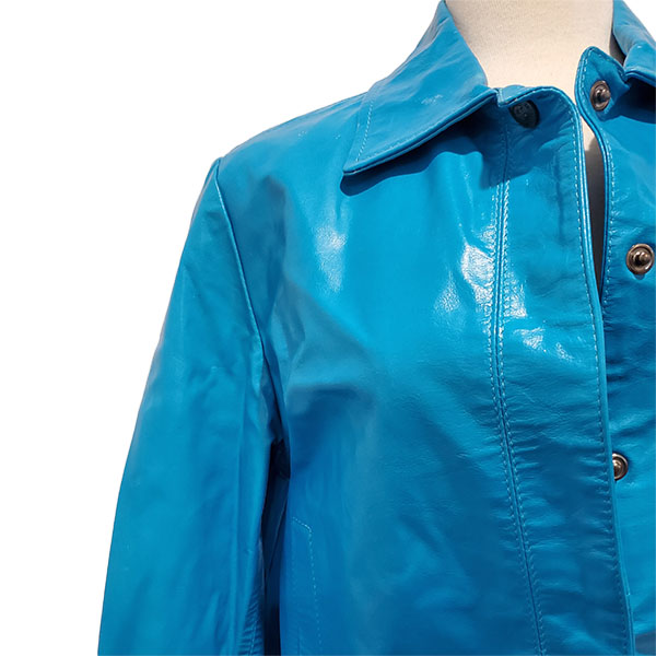 Close up of details of pre-owned Versace Jeans Leather Jacket & Skirt Suit in blue.