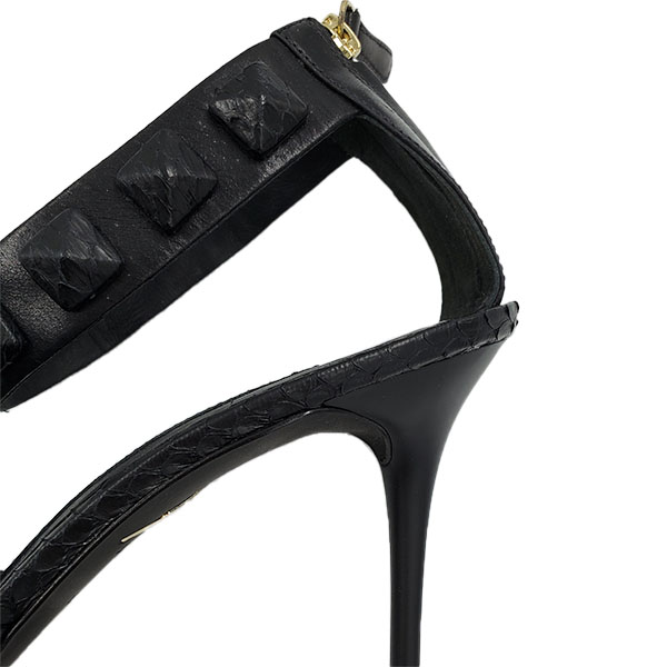 Close up back view of pre-owned Brian Atwood Leather Ankle Strap Pumps in black, with back zip closure.