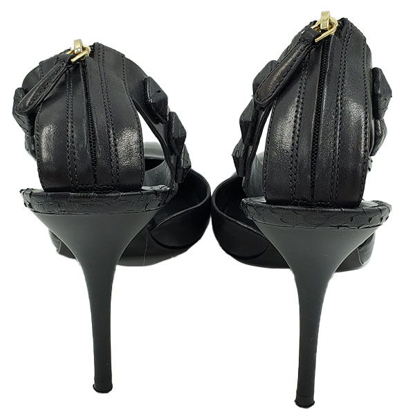 Back view of pre-owned Brian Atwood Leather Ankle Strap Pumps in black, with back zip closure.