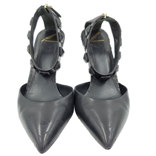 Front view of pre-owned Brian Atwood Leather Ankle Strap Pumps in black, with pointed toes and back zip closure.