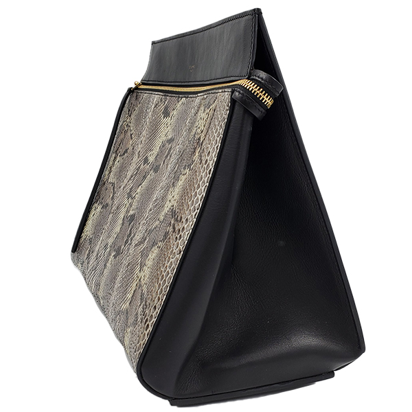 Side view of pre-owned Celine Snakeskin Edge Bag in black, with single flat shoulder strap.