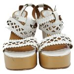 Front view of pre-owned Chloe Perforated Wedge Sandals in white.