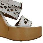 Close up front view of pre-owned Chloe Perforated Wedge Sandals in white.
