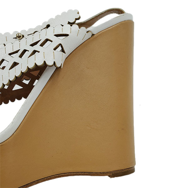 Close up back view of pre-owned Chloe Perforated Wedge Sandals in white, with gold button closure.