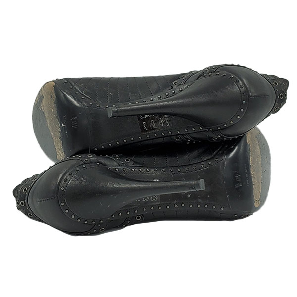 Soles of pre-owned Christian Dior Lace-Up Booties.