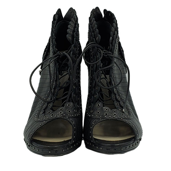Front view of pre-owned Christian Dior Lace-Up Booties in black, with studded design.