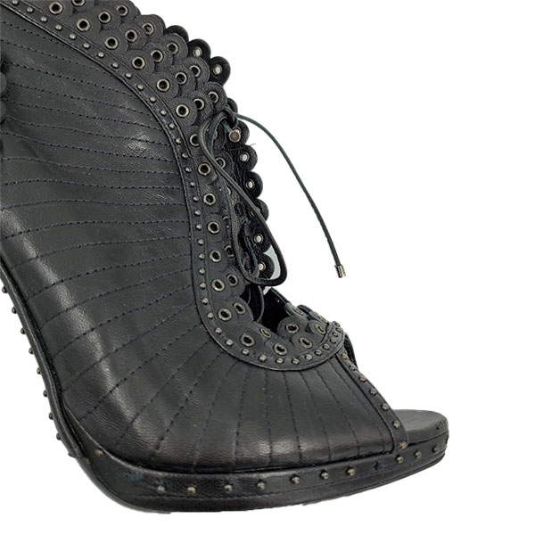Close up front view of pre-owned Christian Dior Lace-Up Booties in black, with studded design.