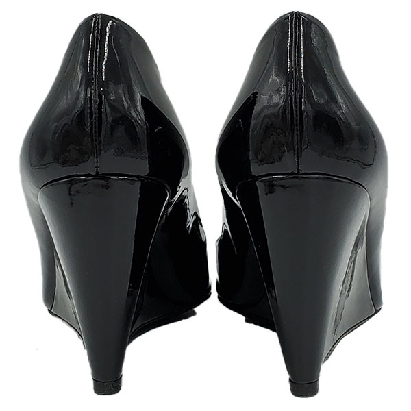 Back view of pre-owned Miu Miu Patent Leather Wedge Sandals in black.