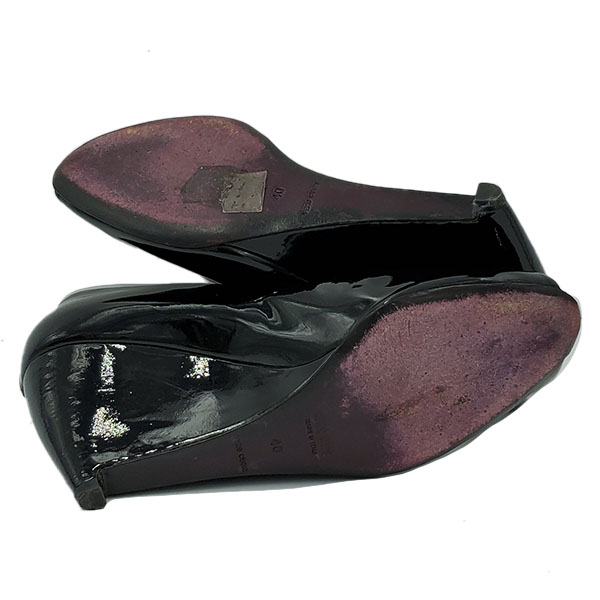 Soles of pre-owned Miu Miu Patent Leather Wedge Sandals.