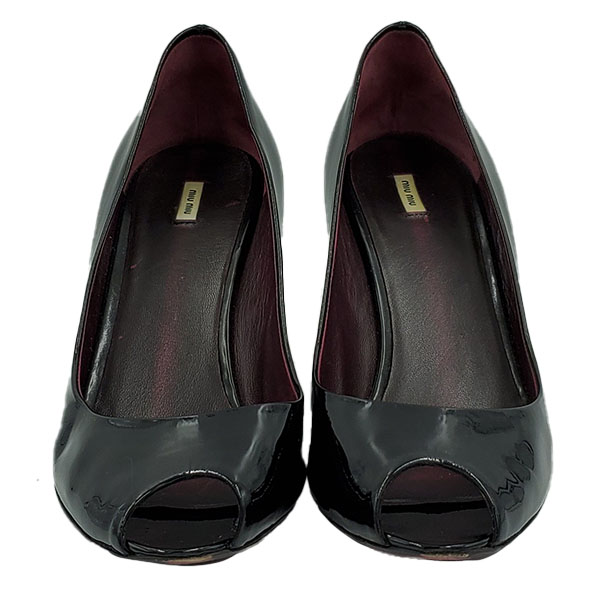 Front view of pre-owned Miu Miu Patent Leather Wedge Sandals in black, with open toe.