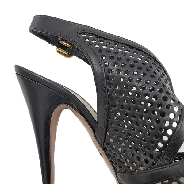 Close up back view of pre-owned Prada Perforated High Heels in black, with gold-tone buckle.