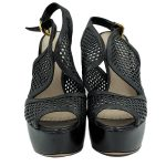 Front view of pre-owned Prada Perforated High Heels in black.