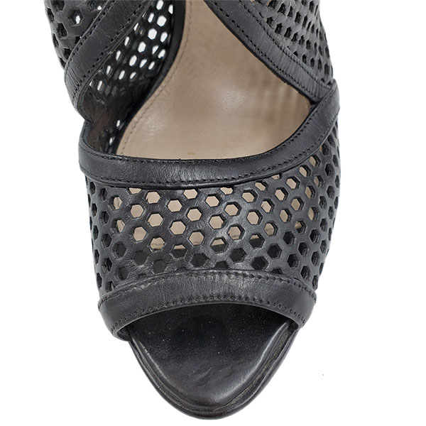 Top view of pre-owned Prada Perforated High Heels in black.