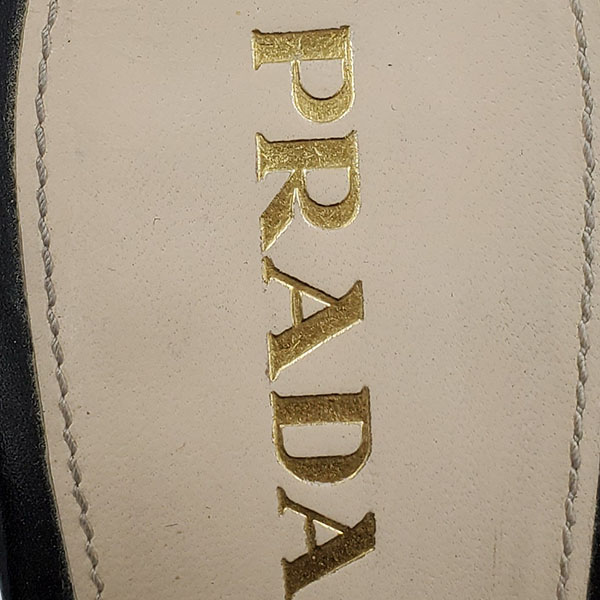 Logo of pre-owned Prada Perforated High Heels.