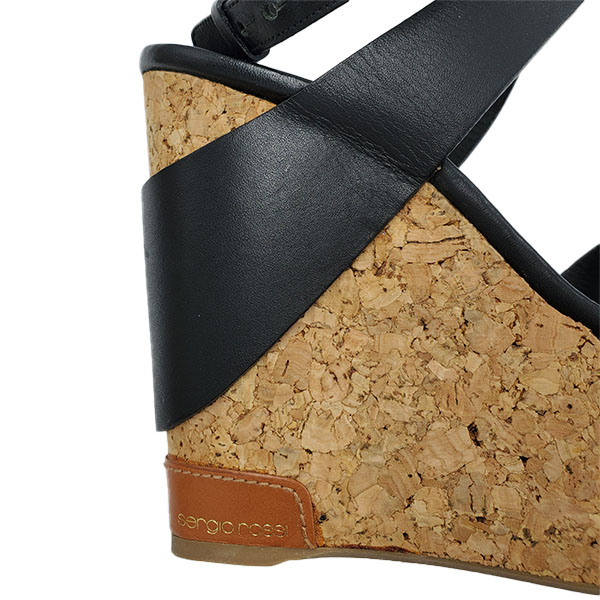 Close up back view of pre-owned Sergio Rossi Cork Platform Wedges in black.