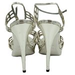 Back view of pre-owned Yves Saint Laurent Patent Leather Platform Sandals in silver, with skinny heels.
