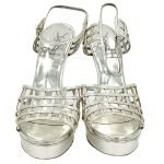 Front view of pre-owned Yves Saint Laurent Patent Leather Platform Sandals in silver, with caged design.