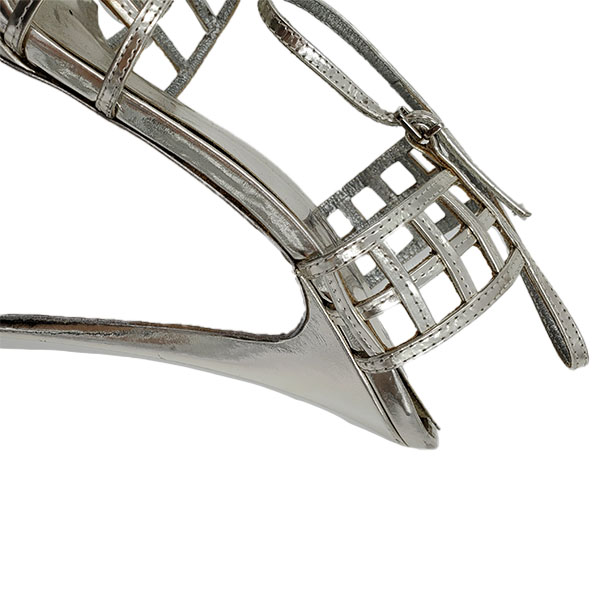 Close up back view of pre-owned Yves Saint Laurent Patent Leather Platform Sandals in silver, with caged design.