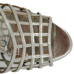 Top view of pre-owned Yves Saint Laurent Patent Leather Platform Sandals in silver, with caged design.