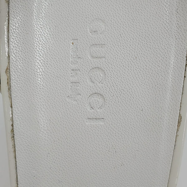 Logo of pre-owned Gucci Patent Leather Wedge Sandals.