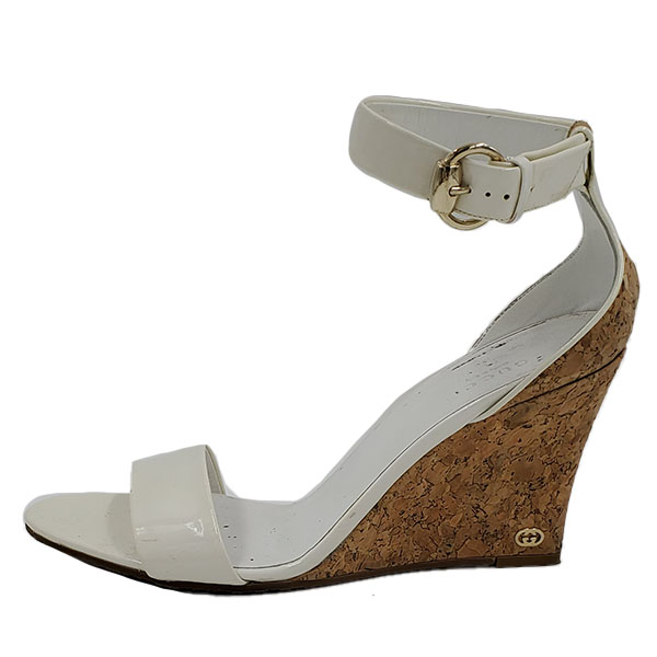Pre-owned Gucci Patent Leather Wedge Sandals in white, with cork heels.