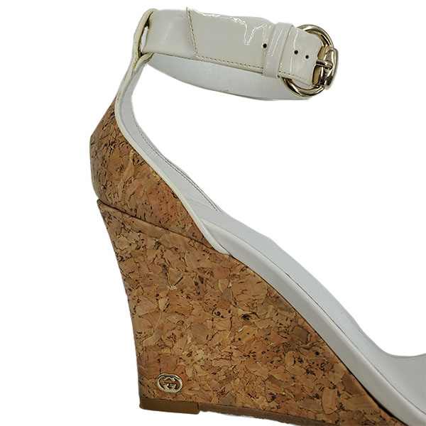 Close up back view of pre-owned Gucci Patent Leather Wedge Sandals in white, with cork heels.