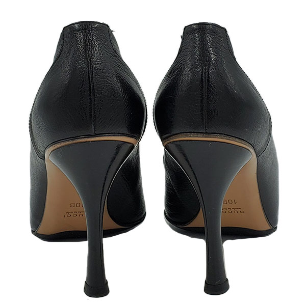 Back view of pre-owned Gucci Pointed Toe Leather Pumps in black, with skinny heels.