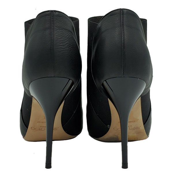 Back view of pre-owned Jimmy Choo Leather Pointed Toe Booties in black, with skinny heels.