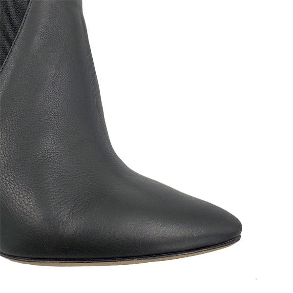 Close up front view of pre-owned Jimmy Choo Leather Pointed Toe Booties in black.