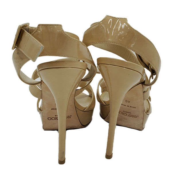Back view of pre-owned Jimmy Choo Patent Leather Strappy Sandals in nude.