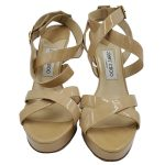 Front view of pre-owned Jimmy Choo Patent Leather Strappy Sandals in nude.