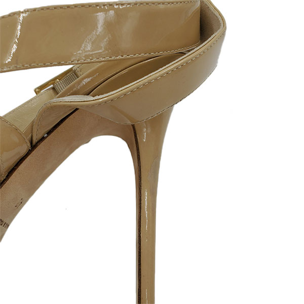 Close up back view of pre-owned Jimmy Choo Patent Leather Strappy Sandals in nude.