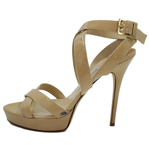 Pre-owned Jimmy Choo Patent Leather Strappy Sandals in nude, with gold-tone buckle.