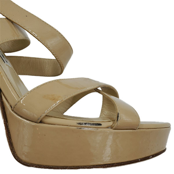 Close up front view of pre-owned Jimmy Choo Patent Leather Strappy Sandals in nude.