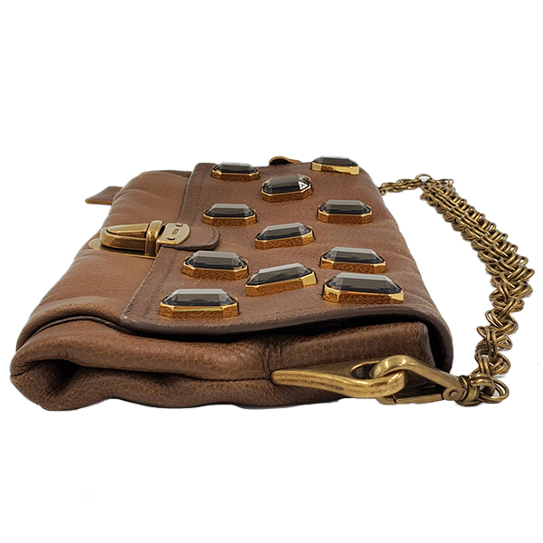 Side view of pre-owned Prada Pietre Jeweled Leather Chain Clutch Shoulder Bag in brown, with chain shoulder strap.
