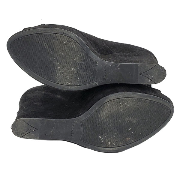 Soles of pre-owned Prada Suede Wedge Sandals.