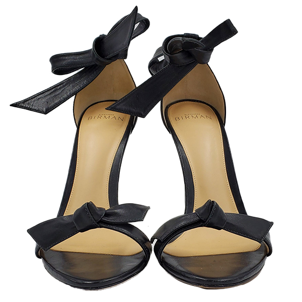 Pre-owned Alexandre Birman Leather Strappy Heels in black, with front leather bow and ankle straps.