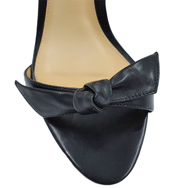 Top view of pre-owned Alexandre Birman Leather Strappy Heels in black, with front leather bow.
