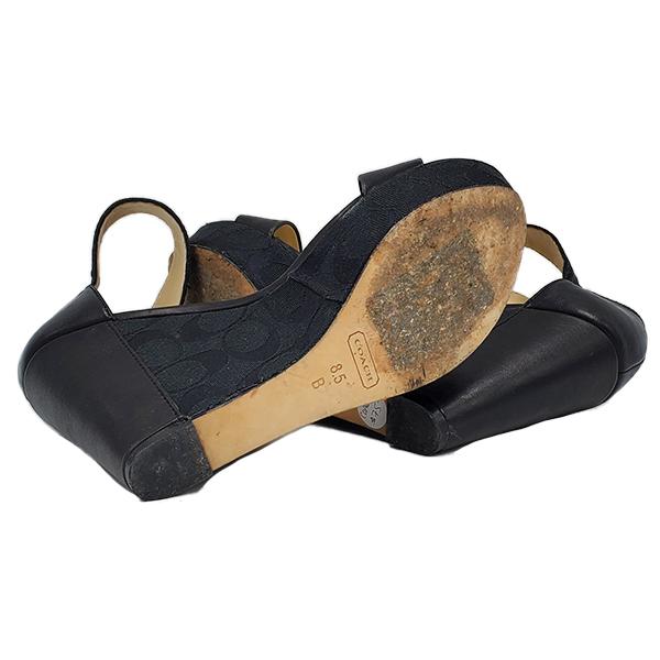 Soles of pre-owned Coach Black Jerri Wedge Sandals.
