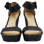 Front view of pre-owned Coach Black Jerri Wedge Sandals with logo printed on wedges.