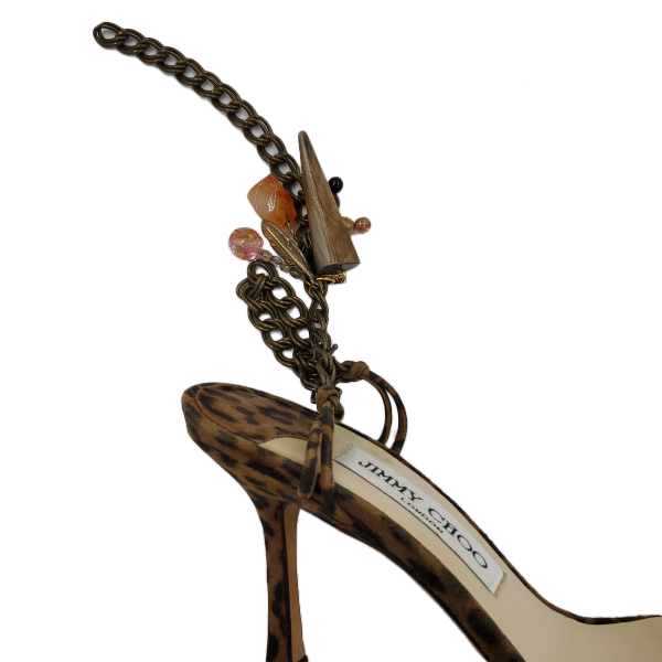 Close up back view of pre-owned Jimmy Choo Leopard Print Ankle Wrap Sandals with ankle bracelet.