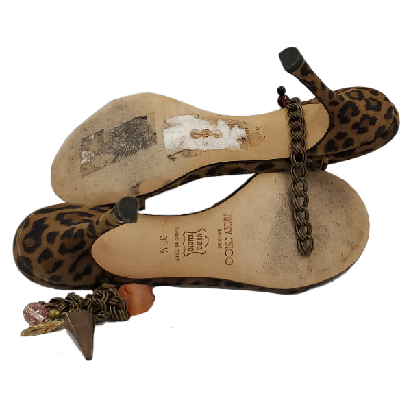 Soles of pre-owned Jimmy Choo Leopard Print Ankle Wrap Sandals.
