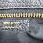 Close up details of pre-owned Burberry Vintage Leather Wristlet.