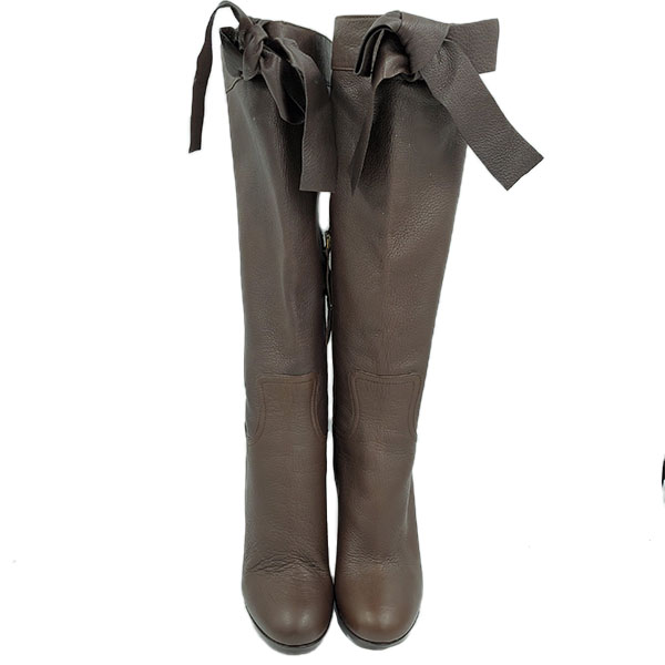 Front view of pre-owned Miu Miu High-knee Boots in brown, with bow tie detail.