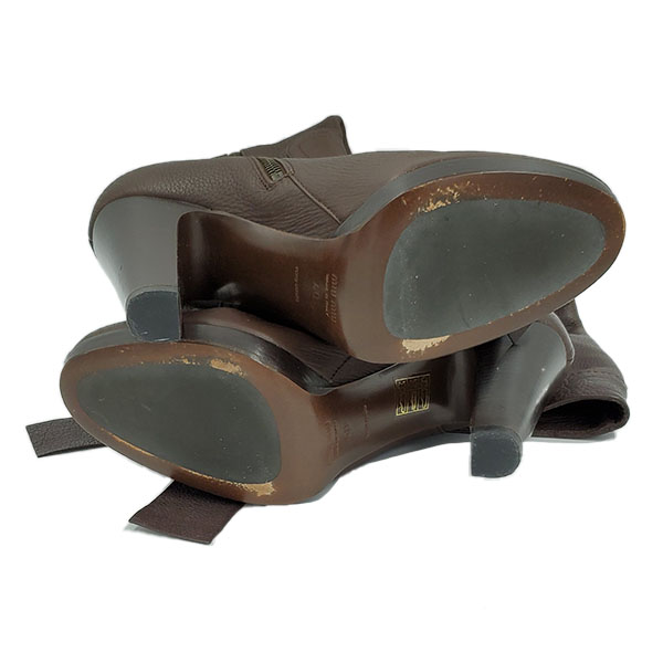 Soles of pre-owned Miu Miu High-knee Boots in brown.