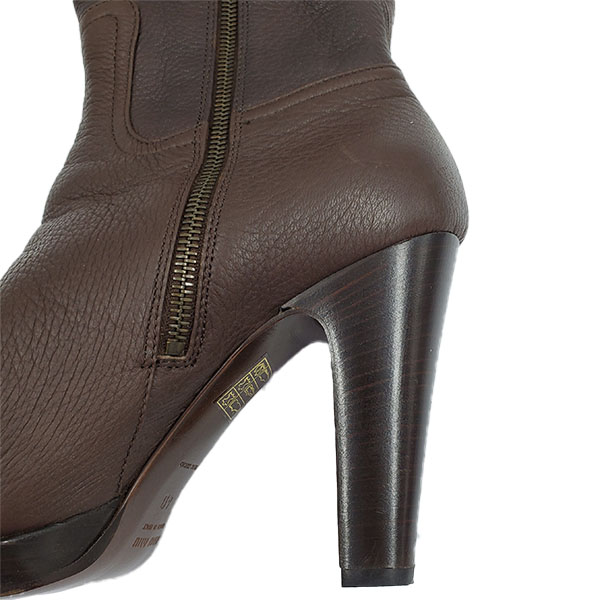 Close up back view of pre-owned Miu Miu High-knee Boots in brown, with side zip closure.