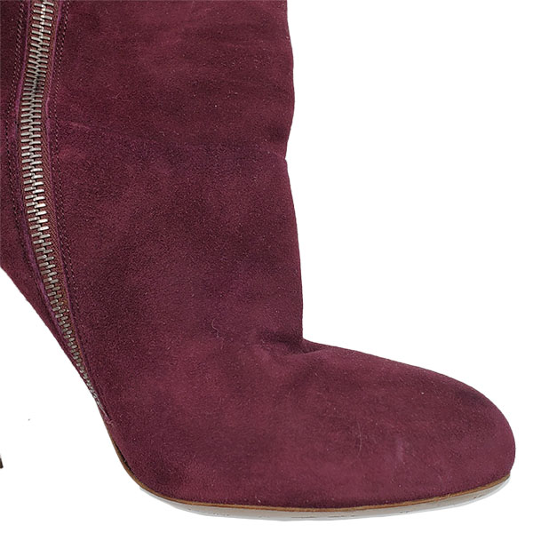 Close up front view of pre-owned Miu Miu Suede Over-the-knee Boots in burgundy, with side zip closure.