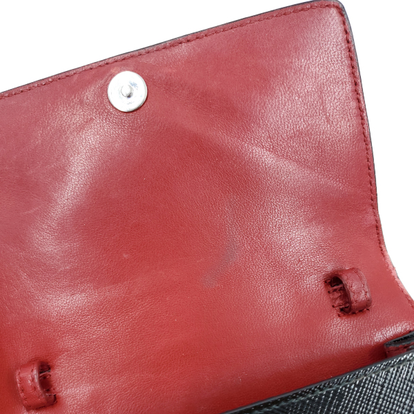 Soft red leather interior of pre-owned Prada Vintage Patent Leather Crossbody Bag.