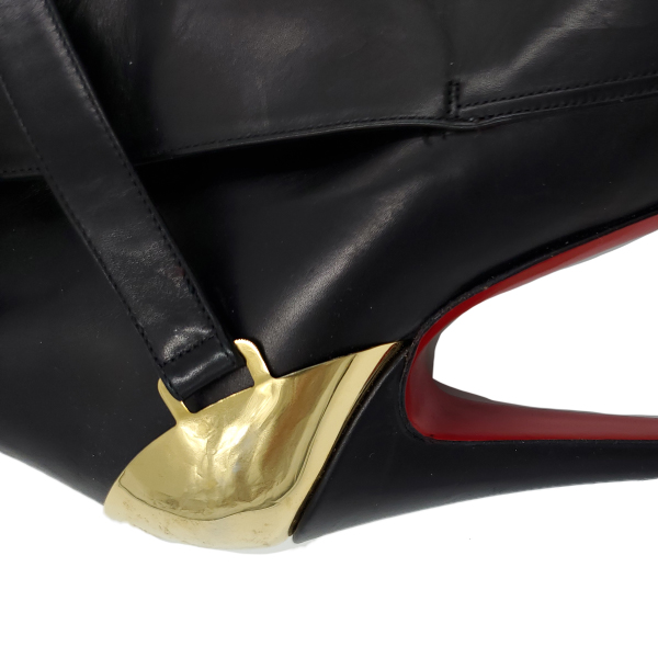 Close up back view of pre-owned Christian Louboutin Calfskin Equestria 160 Boots in black, with ankle straps and gold hardware buckle.