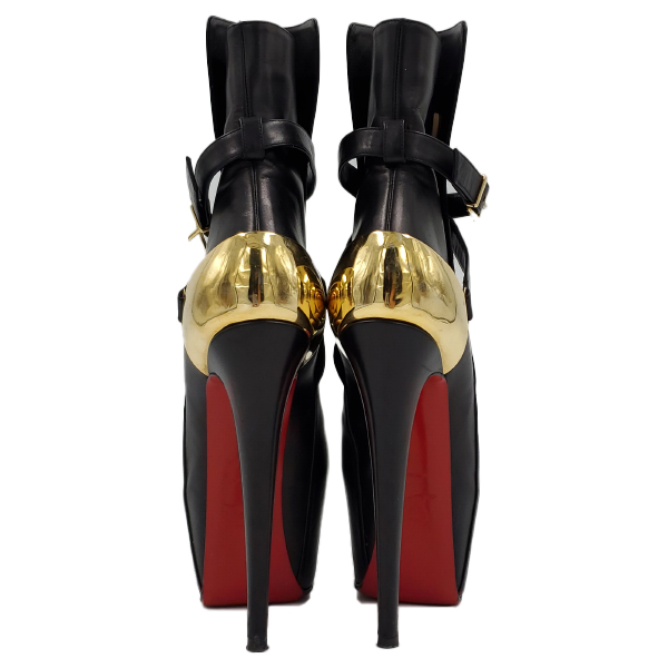 Back view of pre-owned Christian Louboutin Calfskin Equestria 160 Boots in black, with ankle straps and gold hardware buckle.
